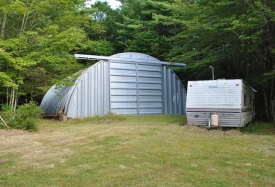 Wooded Campsite - Large metal Quonset hut